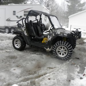 Polaris_RZR_With_7_Plow_and_Tire_Chains01